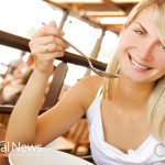 Blonde-Woman-Eating-Soup-Spoon-Smile