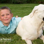 Boy-And-Dog-On-Grass