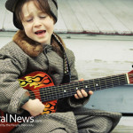 Boy-Child-Playing-Guitar-Singing
