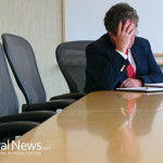 Business-Man-Upset-Stressed-Conference-Table
