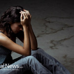 Concerned-Woman-Depressed-Sad-Sitting-Ground