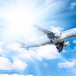 Jumbo-Jet-Airplane-Fly-Sun-Blue-Sky