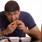 Man-Eating-Hamburger-Processed-Junk-Food