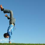 Man-Handstand-Grass-Blue-Sky