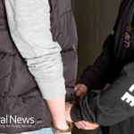 Police-Arrest-Man-Hand-Behind-Back