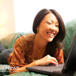 Woman-Asian-Couch-Reading-Computer-Happy-Laptop