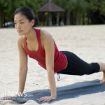 Woman-Asian-Yoga-Pushup-Beach