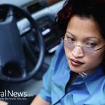 Woman-Glasses-Car-Steering-Wheel