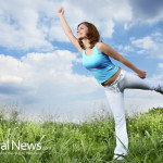 Woman-Grass-Field-Yoga-Pose-Happy