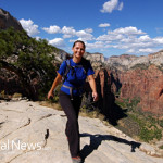 Woman-Hiking-Mountains-Backpack-Smile-Nature-Exercise