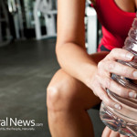 Woman-Holding-Water-Bottle-Plastic-Gym-Workout