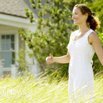Woman-Outside-Grass-Happy-Sunlight