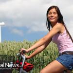 Woman-Ride-Bike-Wind-Power-Grass