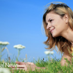 Woman-Smile-Grass-Flowers-Outside