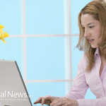 Woman-Working-Home-Computer-Laptop-Flowers