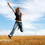 Young-Woman-Happy-Jumping-Field