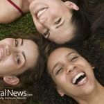 Girls-Laughing-Grass