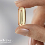 Hand--Holding-Pill-Capsule-Fish-Oil-Vitamin-D