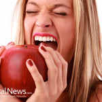 Young-Woman-Eating-Large-Apple-Hands-Bite